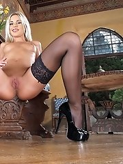Lola uses a decorative glass dildo to fuck her pussy
